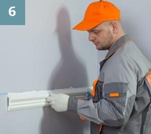 Приложить изделие к месту установкисогласно разметке на стене